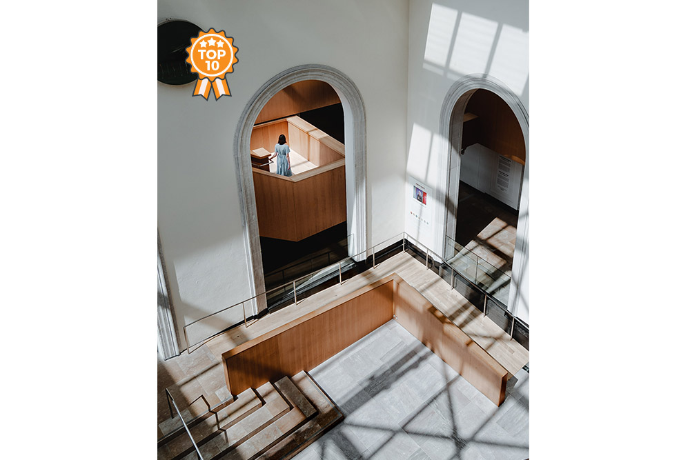 Girl wandering down staircase