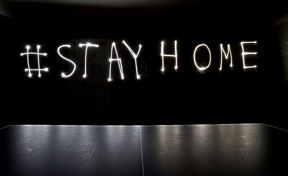 Stay Home written with light