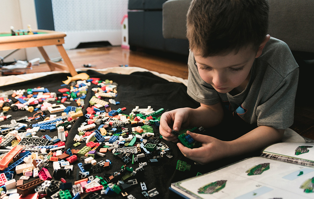 Little boy playing with lego
