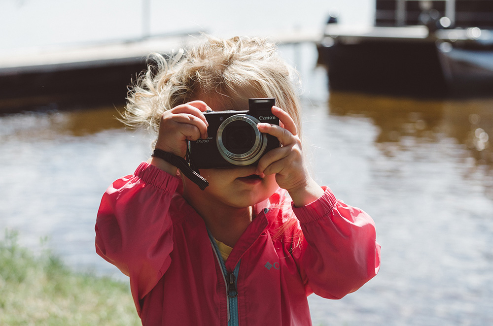 Toddler using a camera