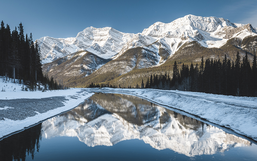 Reflections of distant mountains on a body of water