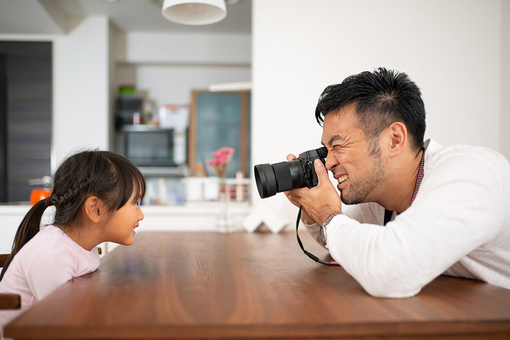 father-taking-photo-of-daughter